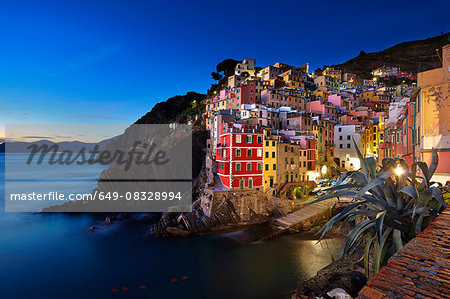 Waterfront town of Riomaggiore at night, Italy Stock Photo - Premium Royalty-Free, Image code: 649-08328994
