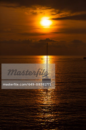Silhouetted yacht at sunset, Camogli, Liguria,  Italy Stock Photo - Premium Royalty-Free, Image code: 649-08381771