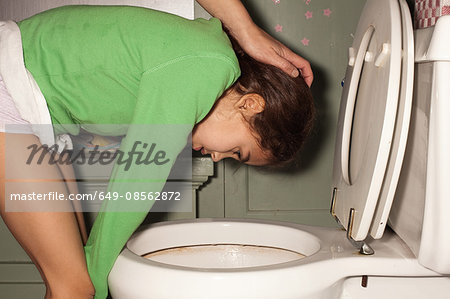 Girl being sick in toilet Stock Photo - Premium Royalty-Free, Image code: 649-08562872