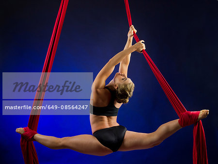 Woman performing acrobatics Stock Photo - Premium Royalty-Free, Image code: 649-08564247