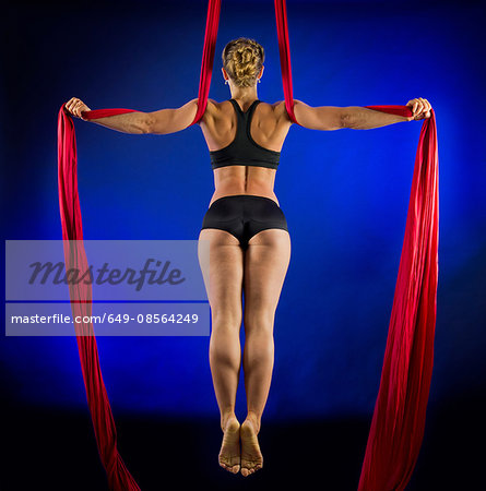 Woman performing acrobatics Stock Photo - Premium Royalty-Free, Image code: 649-08564249