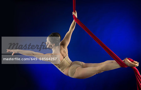 Woman performing acrobatics Stock Photo - Premium Royalty-Free, Image code: 649-08564257