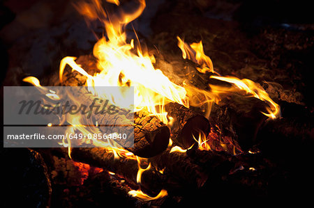 A wood fire inside a Sami lavvu, a traditional, temporary tent, in Kirkeness, Finnmark region, northern Norway Stock Photo - Premium Royalty-Free, Image code: 649-08564840