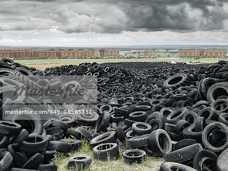 Pile of old tyres outside of city Stock Photo - Premium Royalty-Free, Image code: 649-08565331