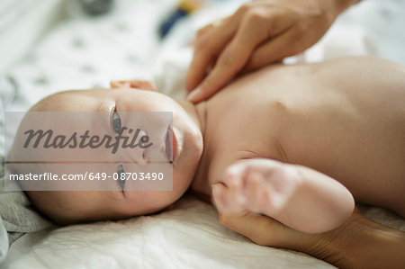 Close up of mothers hand massaging baby son Stock Photo - Premium Royalty-Free, Image code: 649-08703490