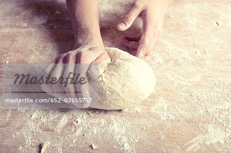 Kneading a dough ball Stock Photo - Premium Royalty-Free, Image code: 652-07655757