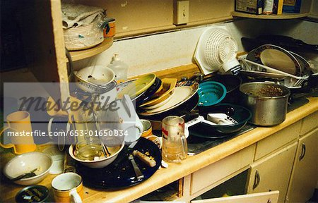 dirty dishes piled in a sink Stock Photo - Premium Royalty-Free, Image code: 653-01650834