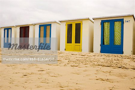 Beach huts on sand in a row Stock Photo - Premium Royalty-Free, Image code: 653-01656732