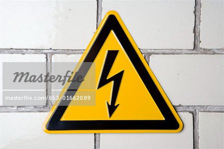 A 'High voltage' warning sign Stock Photo - Premium Royalty-Free, Image code: 653-01662089