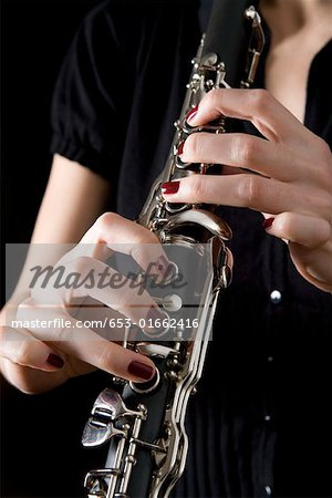 Woman playing a clarinet Stock Photo - Premium Royalty-Free, Image code: 653-01662416