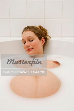 Pregnant woman relaxing in a milk bath Stock Photo - Premium Royalty-Free, Image code: 653-01664296