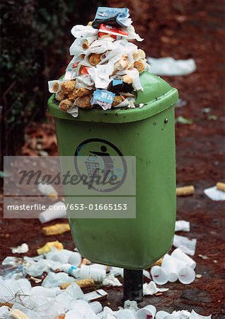 Garbage bin overflowing with trash
