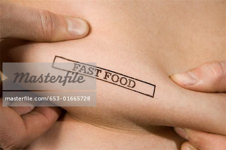 A man pinching part of his abdomen stamped 'Fast Food' Stock Photo - Premium Royalty-Free, Image code: 653-01665728