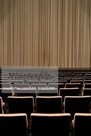Closed curtain in an empty theater Stock Photo - Premium Royalty-Free, Image code: 653-01665888