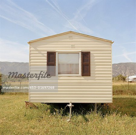 A mobile home in a field Stock Photo - Premium Royalty-Free, Image code: 653-01697268