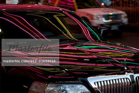 Neon lights reflecting on a limousine Stock Photo - Premium Royalty-Free, Image code: 653-01698614