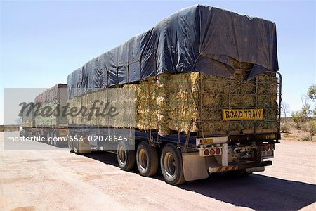 A lorry carrying bales of hay Stock Photo - Premium Royalty-Free, Image code: 653-02078645