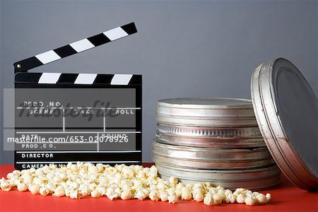 Clapperboard, popcorn and film reels Stock Photo - Premium Royalty-Free, Image code: 653-02078926
