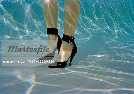 A woman's legs wearing high heels underwater Stock Photo - Premium Royalty-Free, Image code: 653-02260316