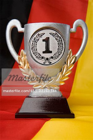 First place trophy sitting on a German flag Stock Photo - Premium Royalty-Free, Image code: 653-02260344