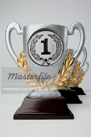 First,second and third place trophies in diminishing perspective Stock Photo - Premium Royalty-Free, Image code: 653-02260355