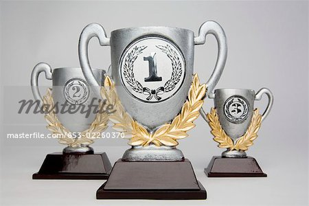 First,second and third place trophies Stock Photo - Premium Royalty-Free, Image code: 653-02260370