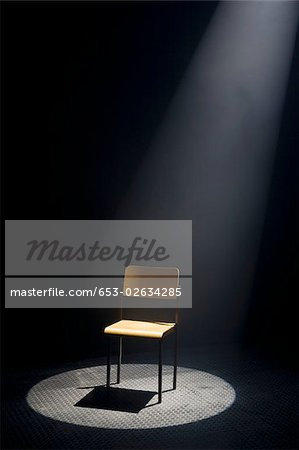 A spot lit empty chair Stock Photo - Premium Royalty-Free, Image code: 653-02634285