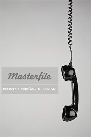 A telephone receiver hanging Stock Photo - Premium Royalty-Free, Image code: 653-02635156