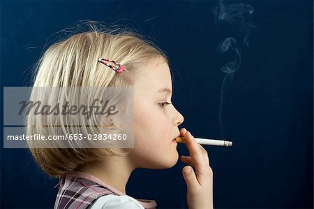 A young girl smoking a cigarette Stock Photo - Premium Royalty-Free, Image code: 653-02834260