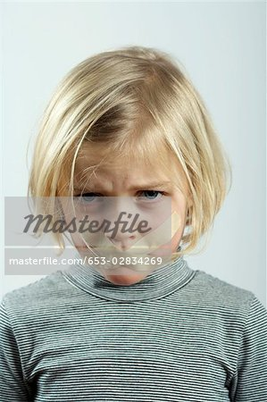 A young girl with tape over her mouth Stock Photo - Premium Royalty-Free, Image code: 653-02834269