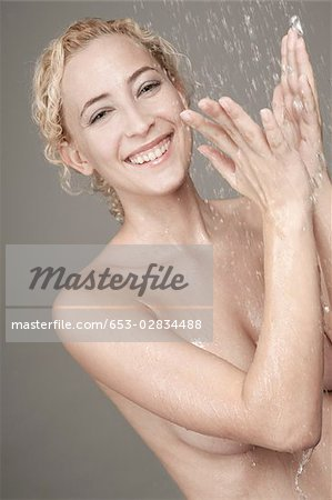 A woman catching running water Stock Photo - Premium Royalty-Free, Image code: 653-02834488