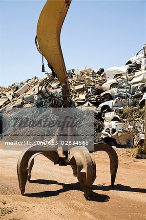 A hydraulic crane in a scrap metal yard Stock Photo - Premium Royalty-Free, Image code: 653-02834565
