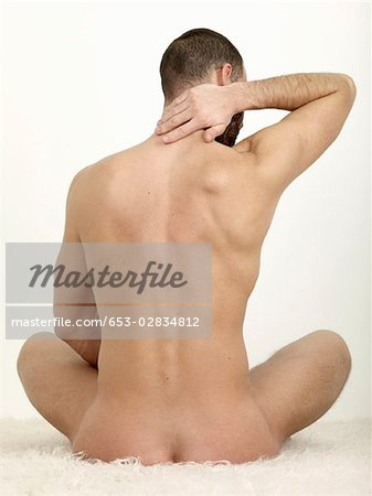 Rear View Of A Naked Man Sitting Stock Premium Royalty