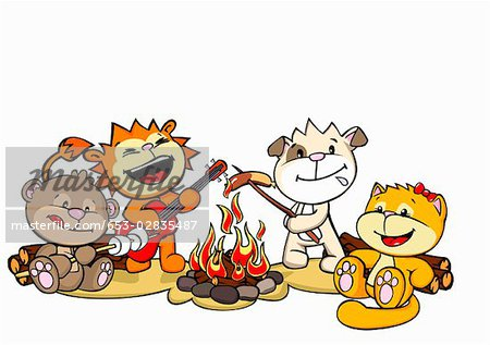 Four friends at a campfire Stock Photo - Premium Royalty-Free, Image code: 653-02835487