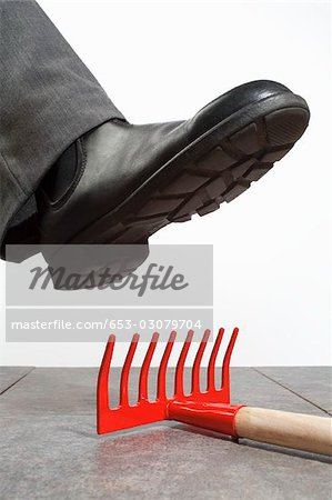 A foot above a rake Stock Photo - Premium Royalty-Free, Image code: 653-03079704