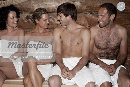 Four friends in a sauna Stock Photo - Premium Royalty-Free, Image code: 653-03333813