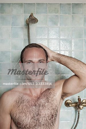 A man taking a shower in a spa Stock Photo - Premium Royalty-Free, Image code: 653-03333816