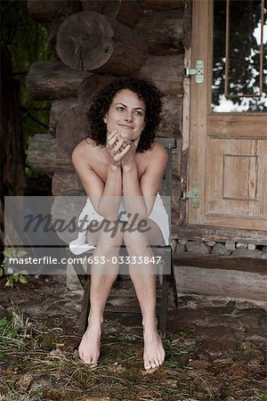 A woman relaxing outside the sauna at a health spa Stock Photo - Premium Royalty-Free, Image code: 653-03333847