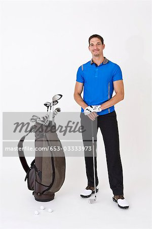 A man standing with golfing equipment Stock Photo - Premium Royalty-Free, Image code: 653-03333973