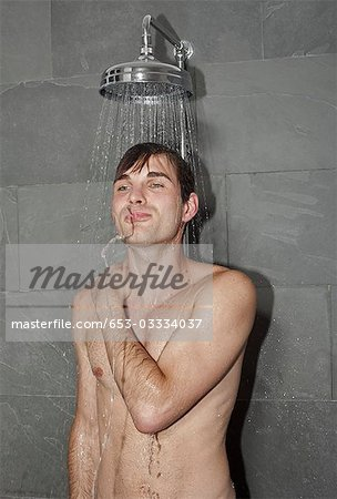 A man taking a shower Stock Photo - Premium Royalty-Free, Image code: 653-03334037