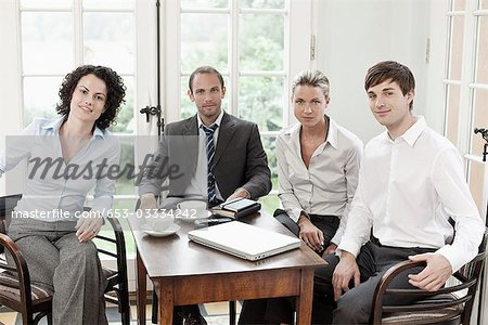 Portrait of business colleagues in a meeting Stock Photo - Premium Royalty-Free, Image code: 653-03334242