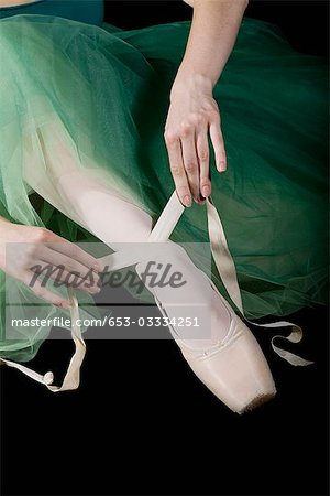 The hands of ballet dancer tying a pointe shoe Stock Photo - Premium Royalty-Free, Image code: 653-03334251