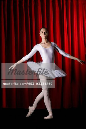 A ballet dancer posing on stage Stock Photo - Premium Royalty-Free, Image code: 653-03334260