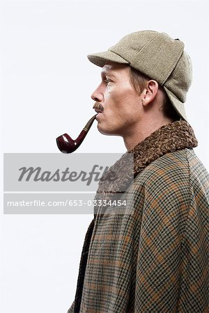 A man dressed up as Sherlock Holmes Stock Photo - Premium Royalty-Free, Image code: 653-03334454