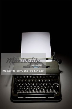 An old-fashioned typewriter with paper Stock Photo - Premium Royalty-Free, Image code: 653-03334620