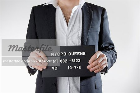 Midsection of a man posing for a mug shot Stock Photo - Premium Royalty-Free, Image code: 653-03459233