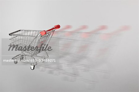A miniature shopping cart on the move Stock Photo - Premium Royalty-Free, Image code: 653-03459271
