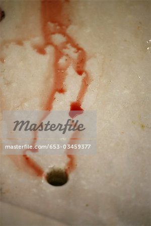 Detail of blood flowing into a drain Stock Photo - Premium Royalty-Free, Image code: 653-03459377