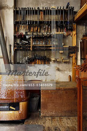 New and old vices hanging in a woodworkers workshop Stock Photo - Premium Royalty-Free, Image code: 653-03459379