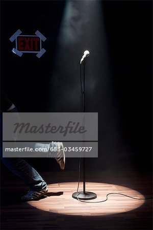A Person Running Off A Stage Stock Photo - Premium Royalty-Free, Image code: 653-03459727